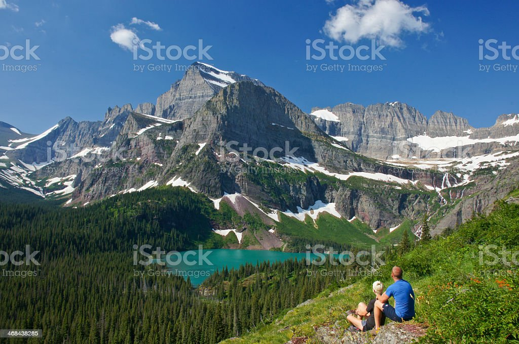 Couple enjoying the view in Glacier National Park stock photo