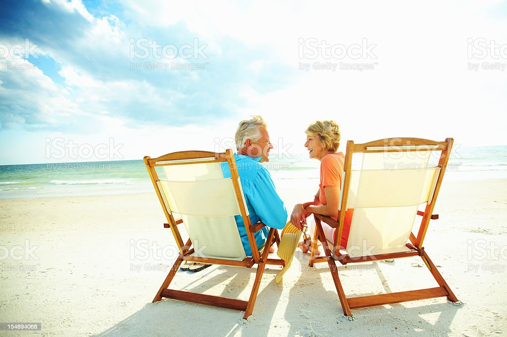 Couple enjoying their golden years on the beach stock photo