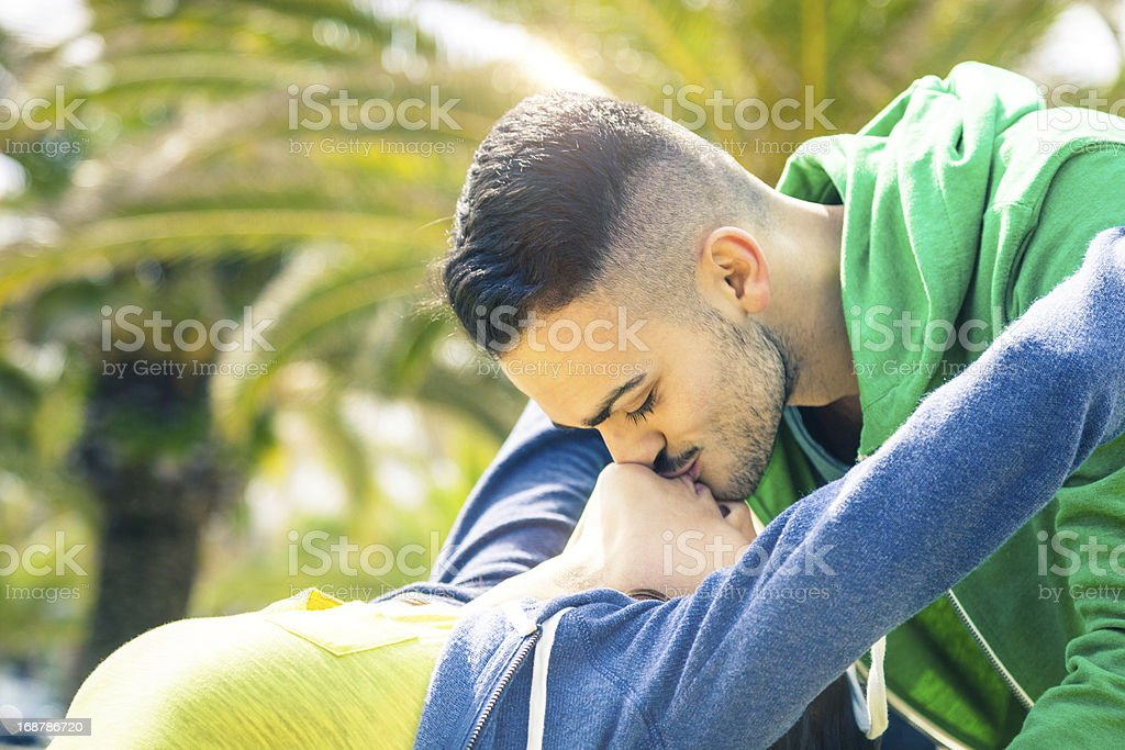 Couple enjoying their relationship, lovely kiss - Side View royalty-free stock photo