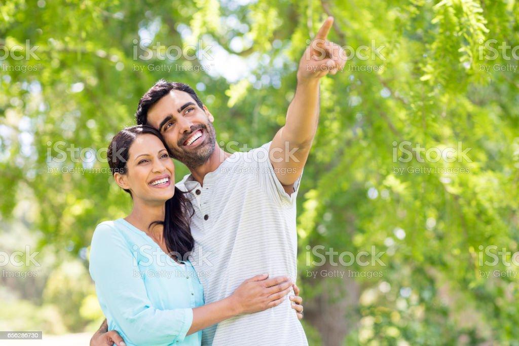 Couple enjoying together in park stock photo