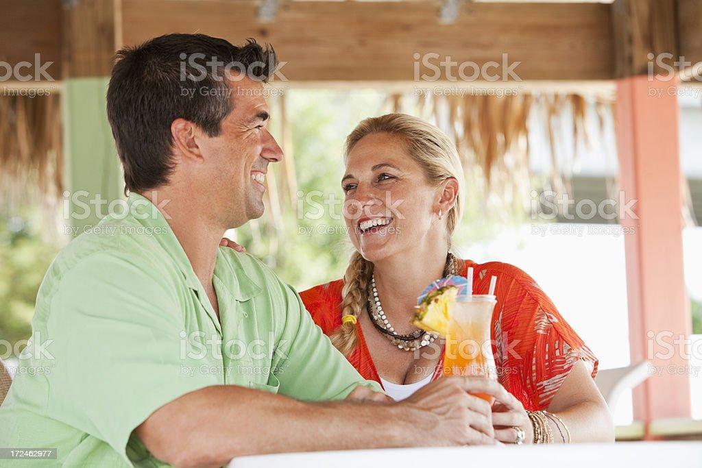 Couple enjoying tropical drinks royalty-free stock photo