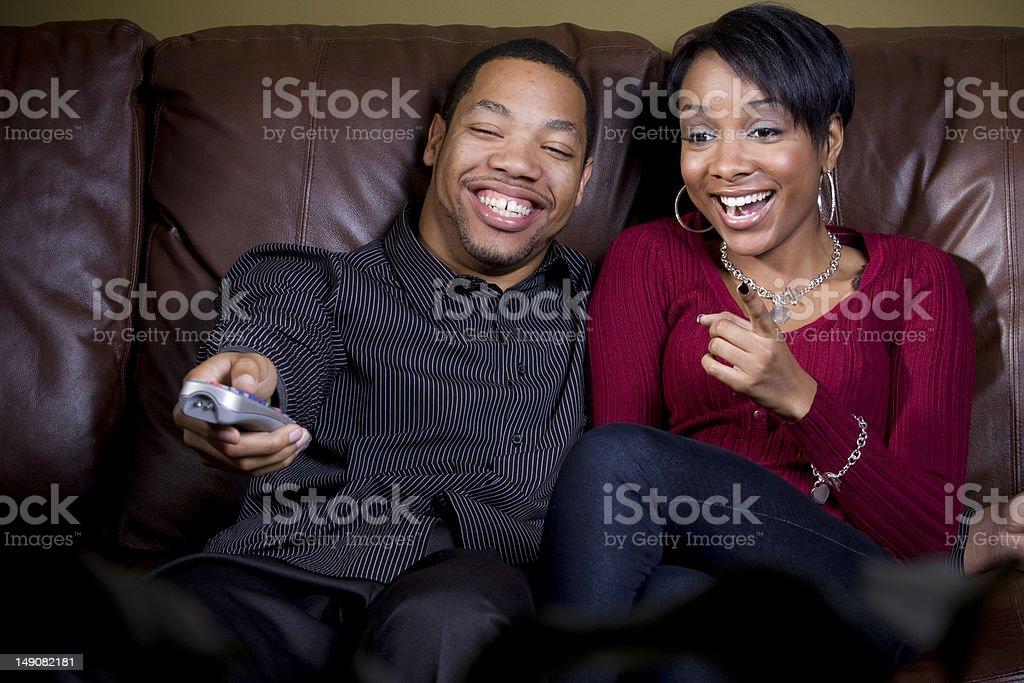 couple enjoying tv together royalty-free stock photo