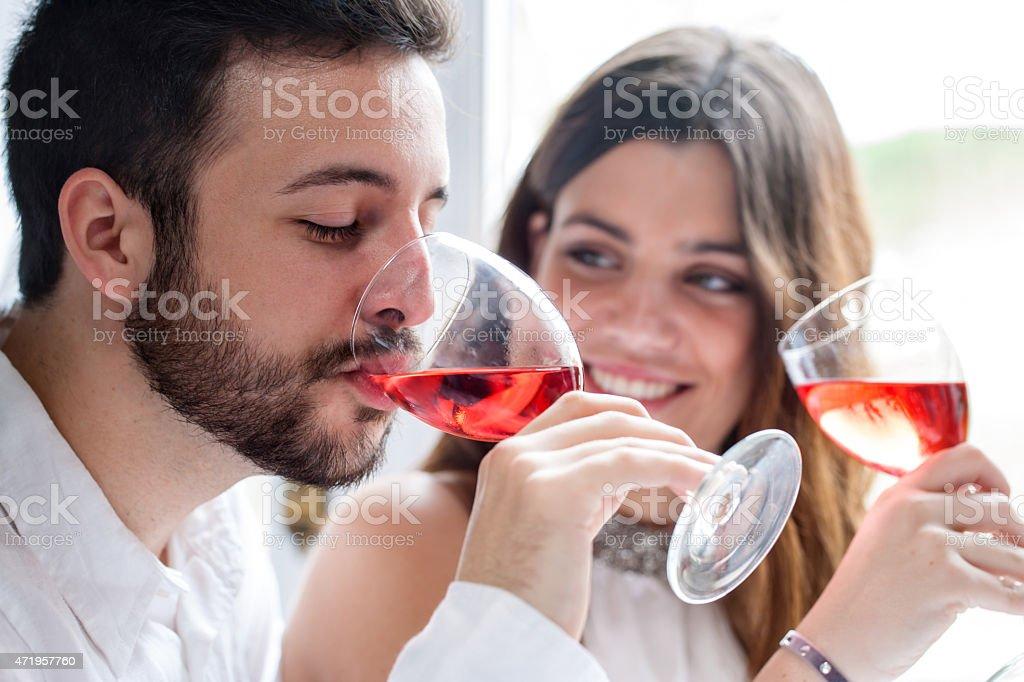 Couple enjoying wine tasting. stock photo