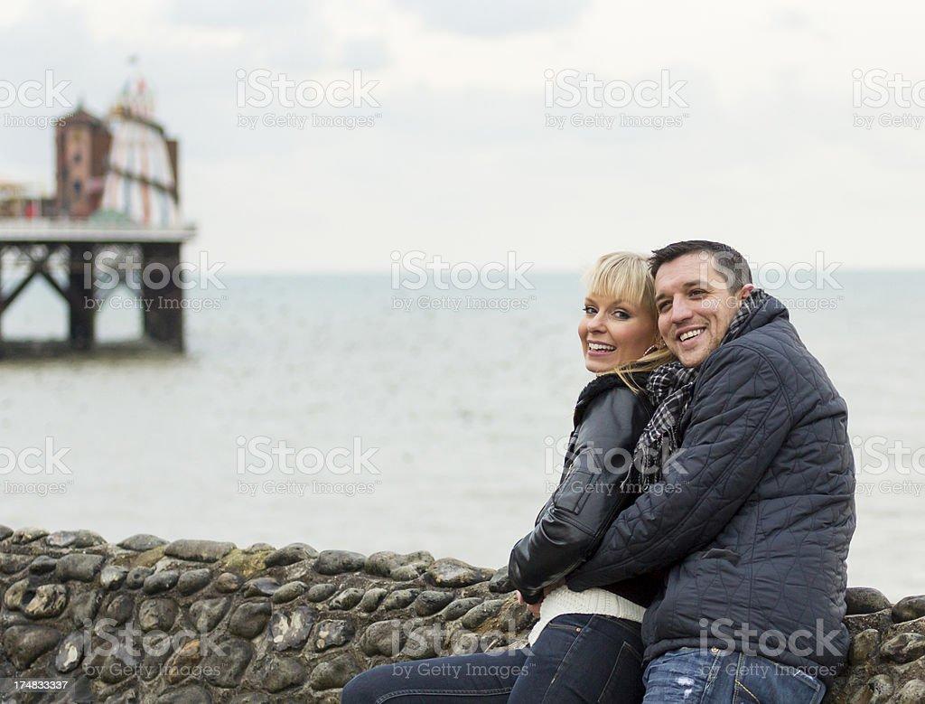 Couple enjoying winter day at Brighton seaside stock photo