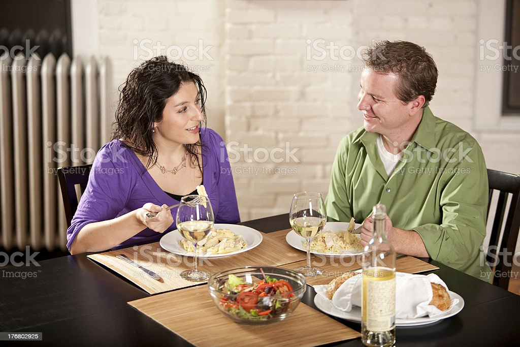 Couple Enjoys a Meal Together royalty-free stock photo