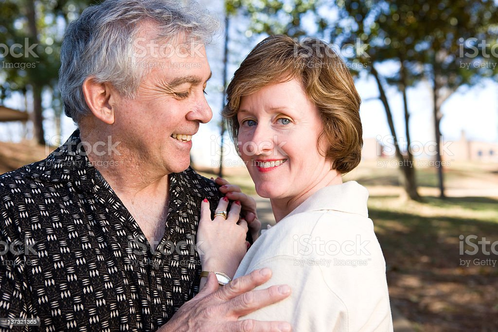 Couple Enjoys Life In A Park royalty-free stock photo