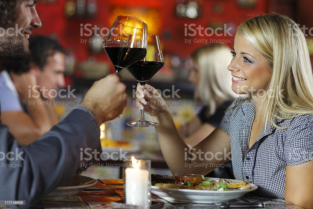 couple enjoys Mexican food stock photo