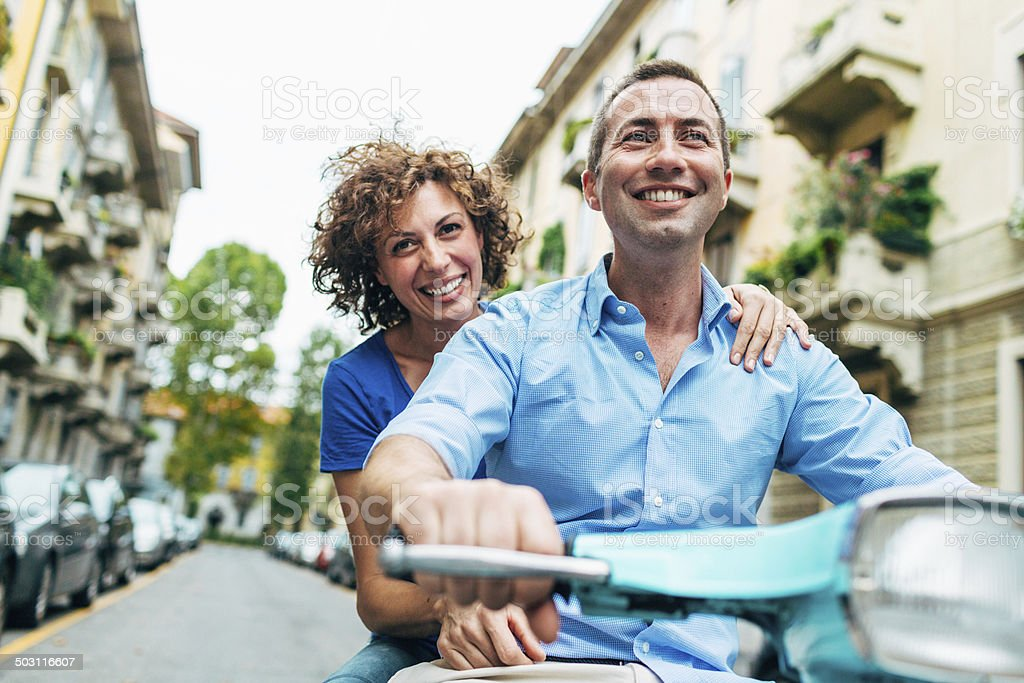 Couple enjoys on a scooter stock photo
