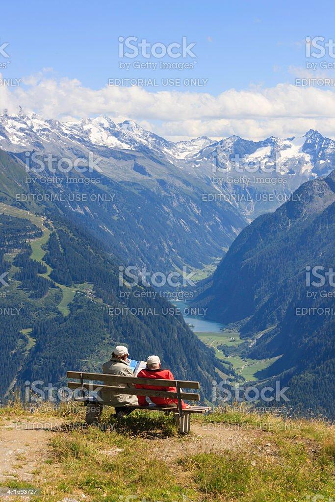 Couple enjoys panorama of the European alps royalty-free stock photo