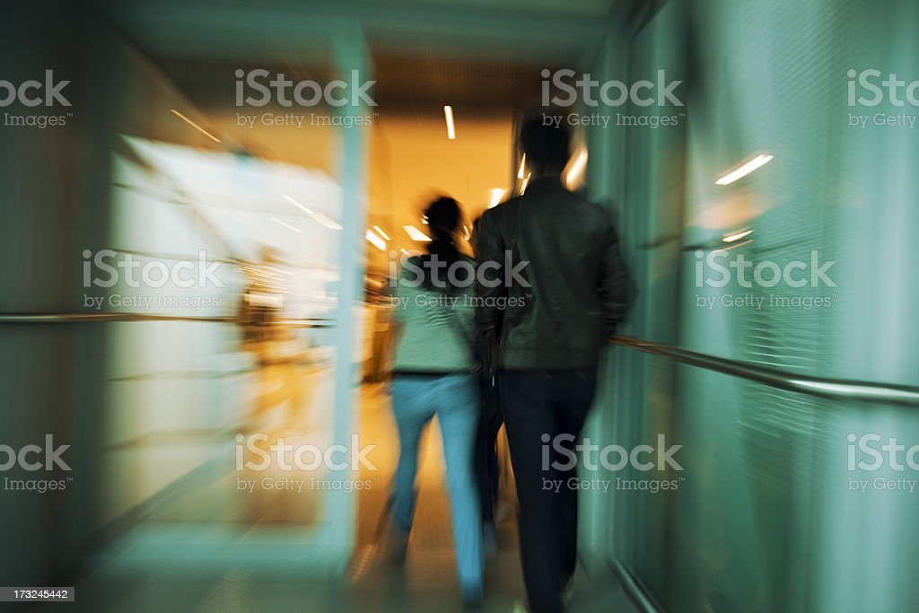 Couple Entering Store, Blurred Motion stock photo