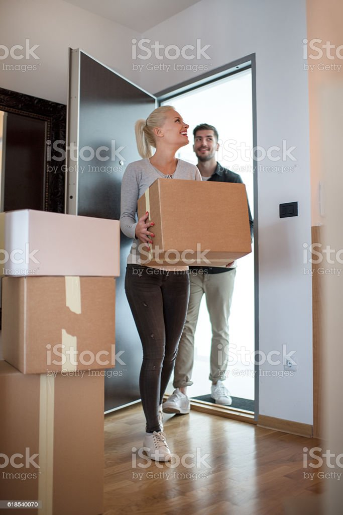Couple entering the new flat stock photo