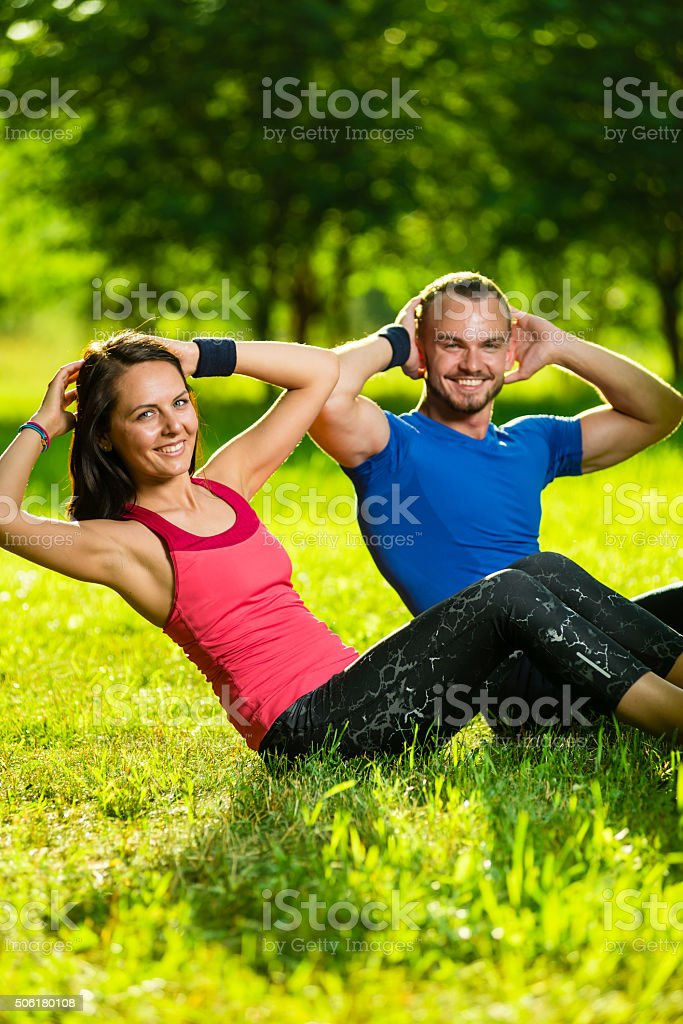 Couple exercising at the city park. Outdoor sport stock photo