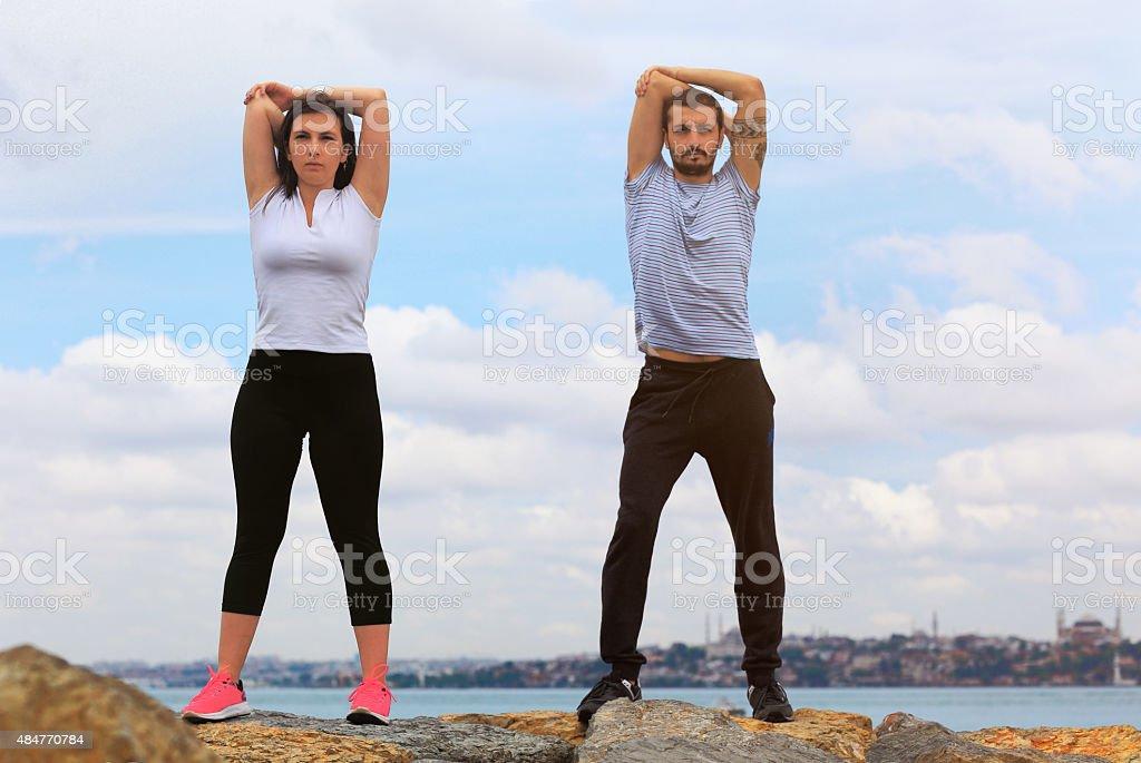 Couple exercising near Istanbul Bosphorus stock photo