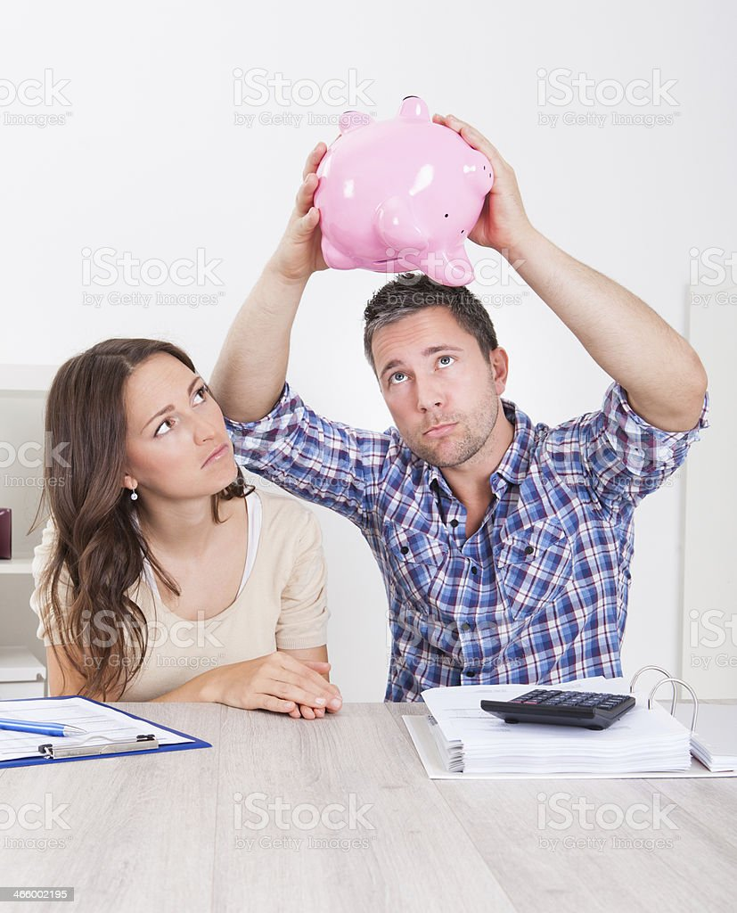 Couple Expecting Money From Piggybank royalty-free stock photo