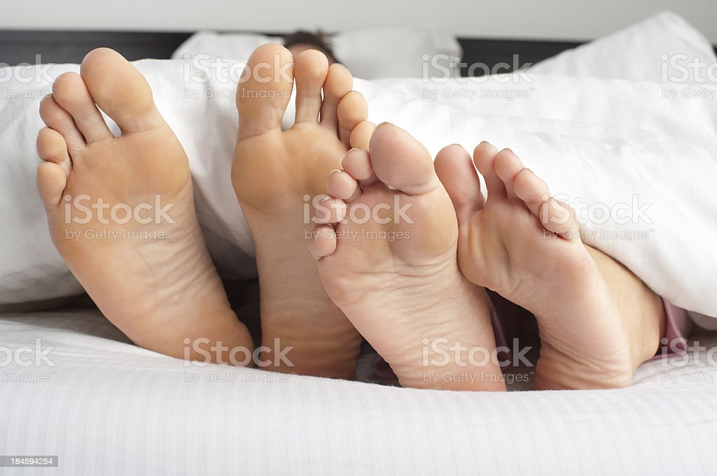 Couple feet poking out stock photo