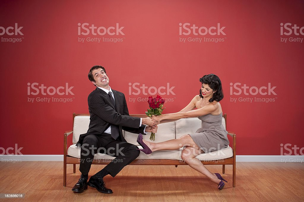 Couple Figitng Over Roses stock photo