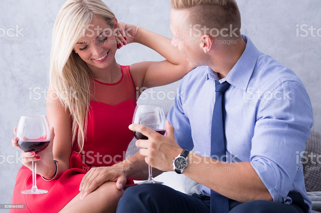 Couple flirting and drinking wine stock photo