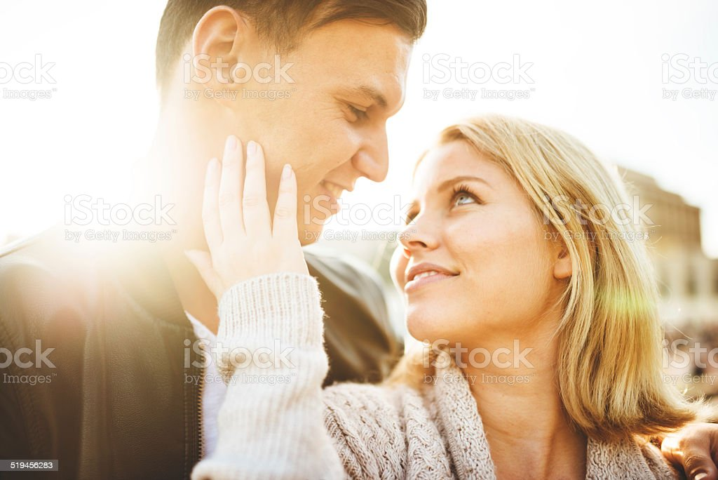 couple flirting at sunlight stock photo