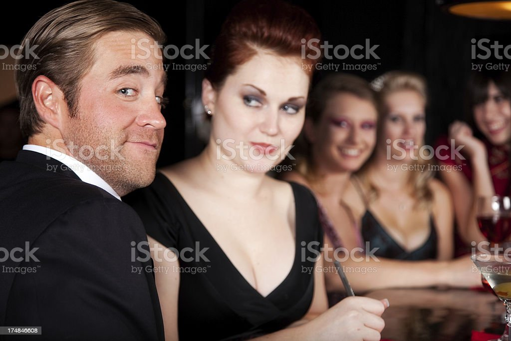 Couple Flirting in Bar- Exchaning Phone Numbers royalty-free stock photo