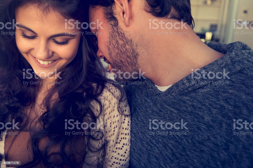 Couple flirting playfully. stock photo
