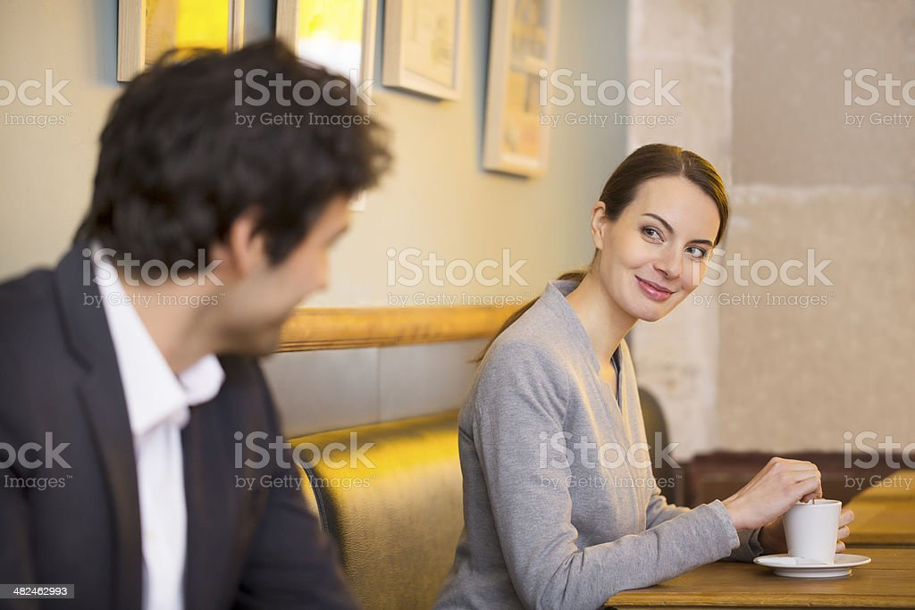 Couple Flirting Together In Bar stock photo