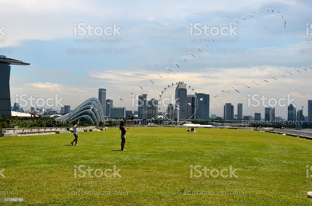 Couple fly two kites infront of Marina Bay Sands, Singapore stock photo