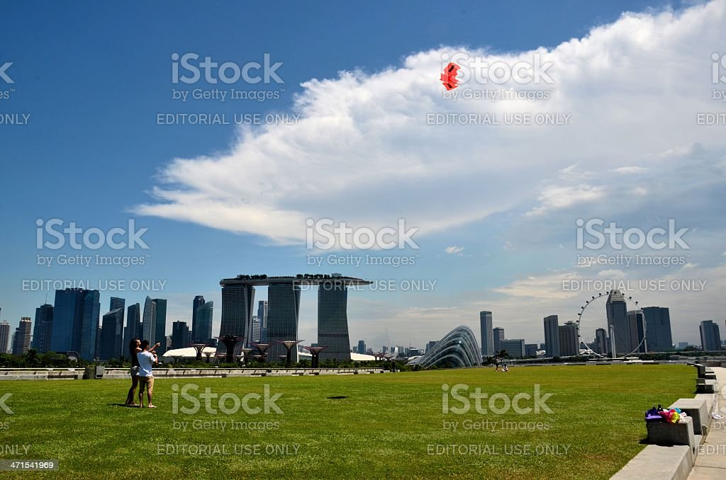 Couple flying kite infront of Marina Bay Sands, Singapore stock photo