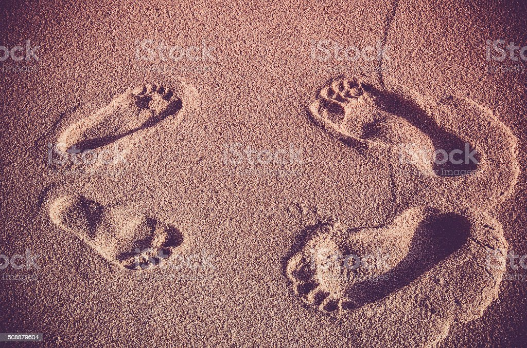 Couple footprints in the sand stock photo