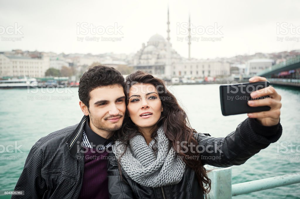 Couple Framing A Selfie In Istanbul Near The Sea stock photo