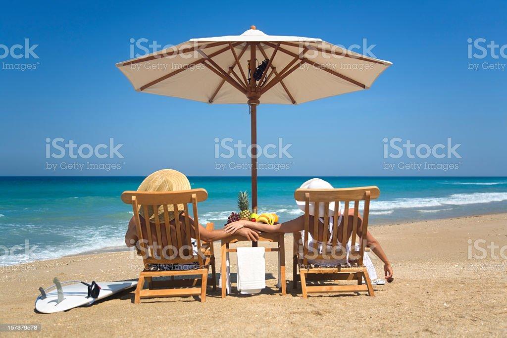 couple getaway at a beach royalty-free stock photo