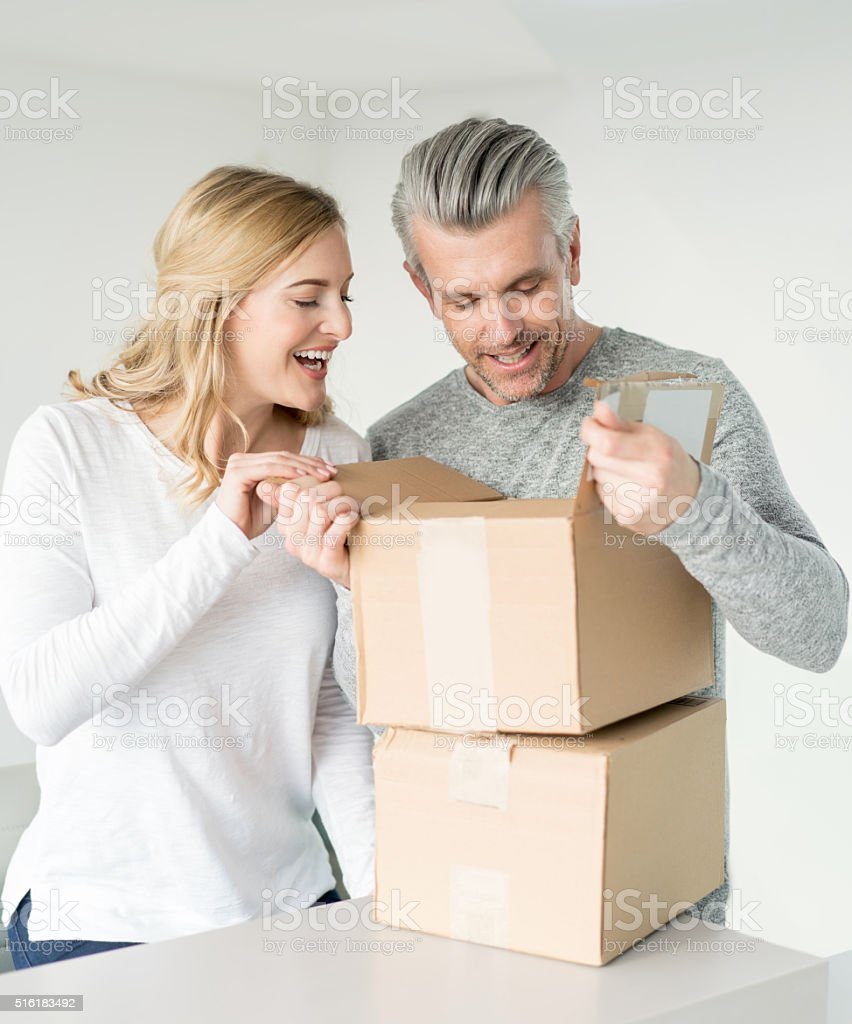 Couple getting a package in the mail stock photo