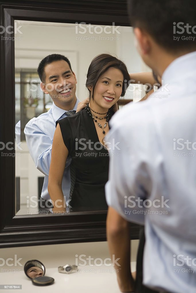 Couple Getting Dressed stock photo