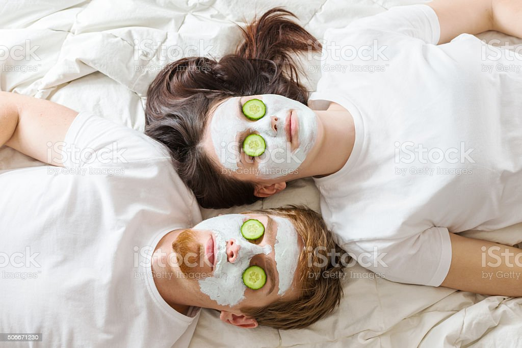Couple getting homemade facial mask stock photo