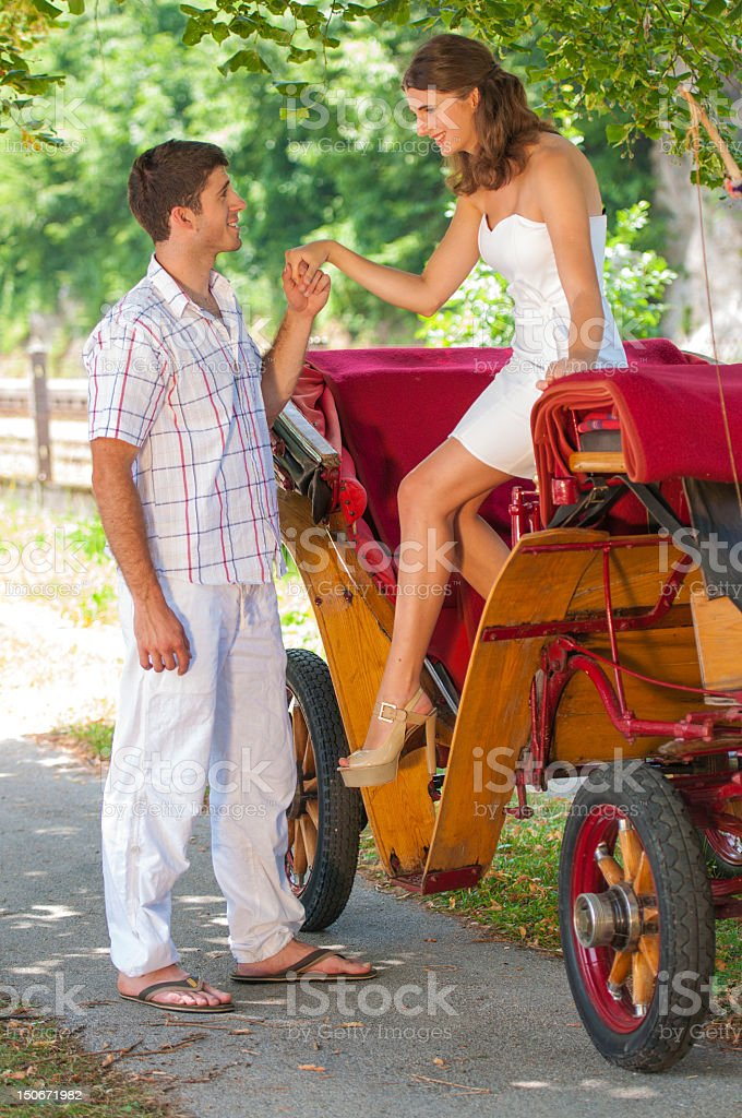 Couple getting off of a carriage stock photo