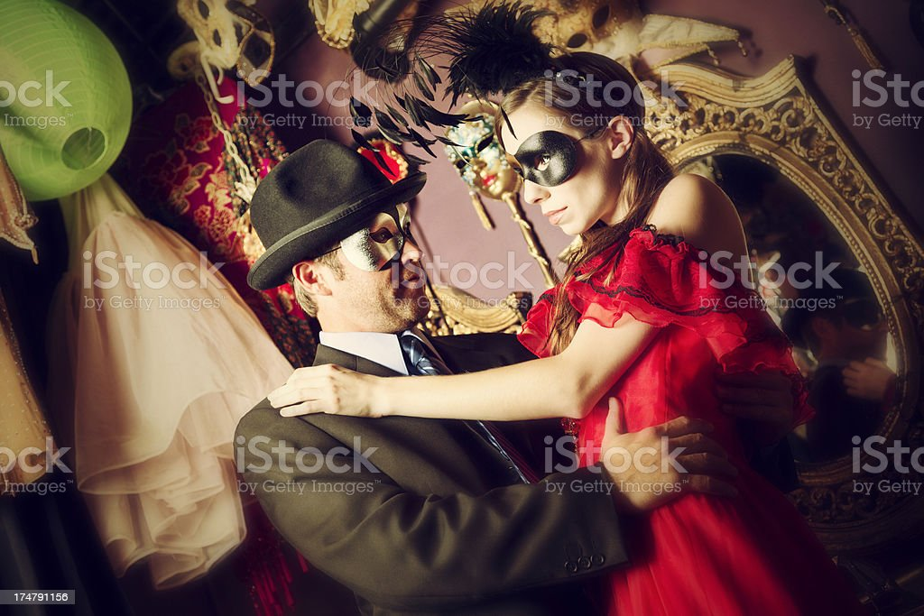Couple getting ready for the masquerade ball stock photo