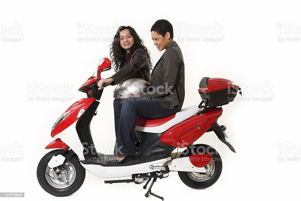 couple girls talking on  scooter royalty-free stock photo