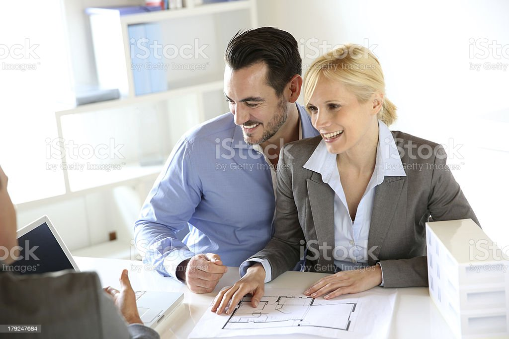 Couple giving agree to buy their new house royalty-free stock photo