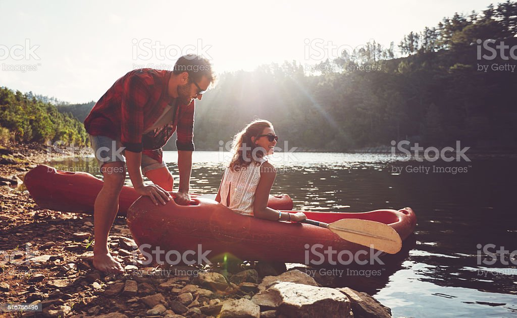 Couple going for kayaking in lake stock photo