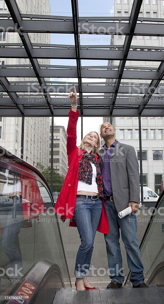 couple going up subway escalators royalty-free stock photo