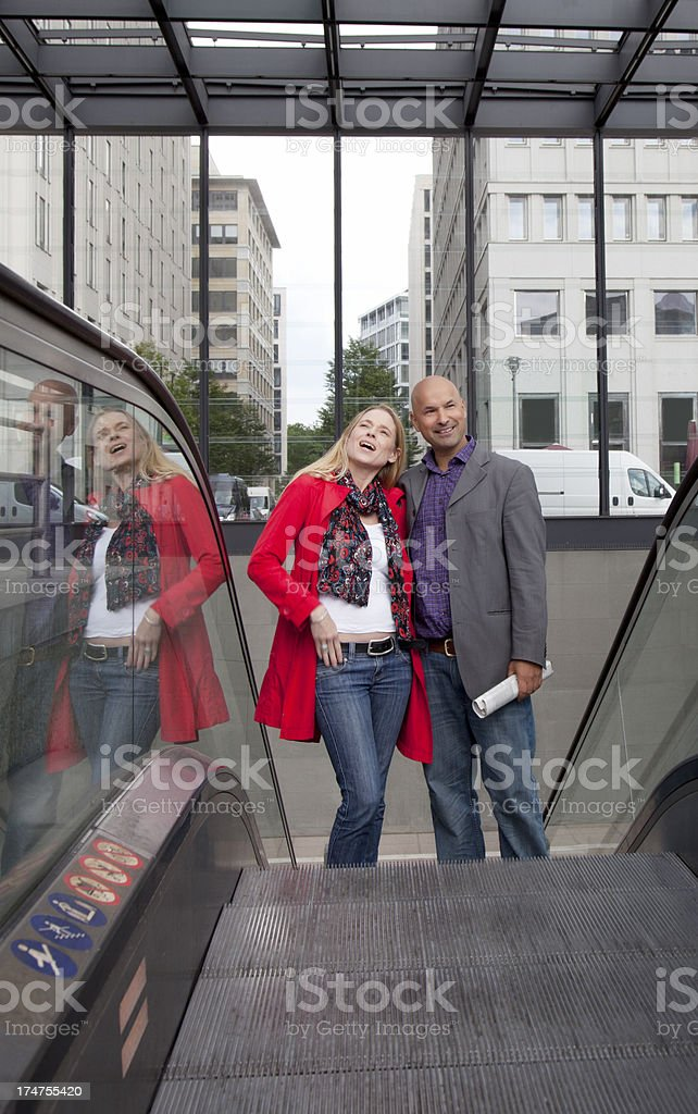 couple going up the escalators royalty-free stock photo