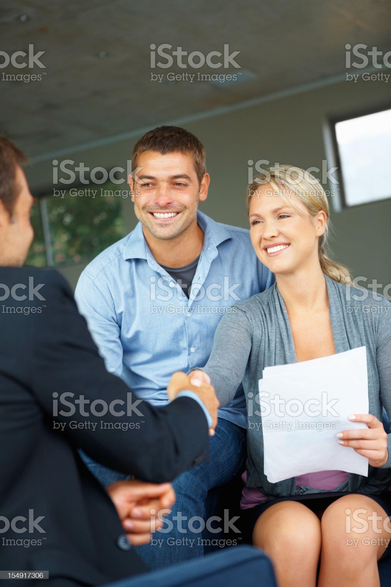 Couple greeting advisor royalty-free stock photo
