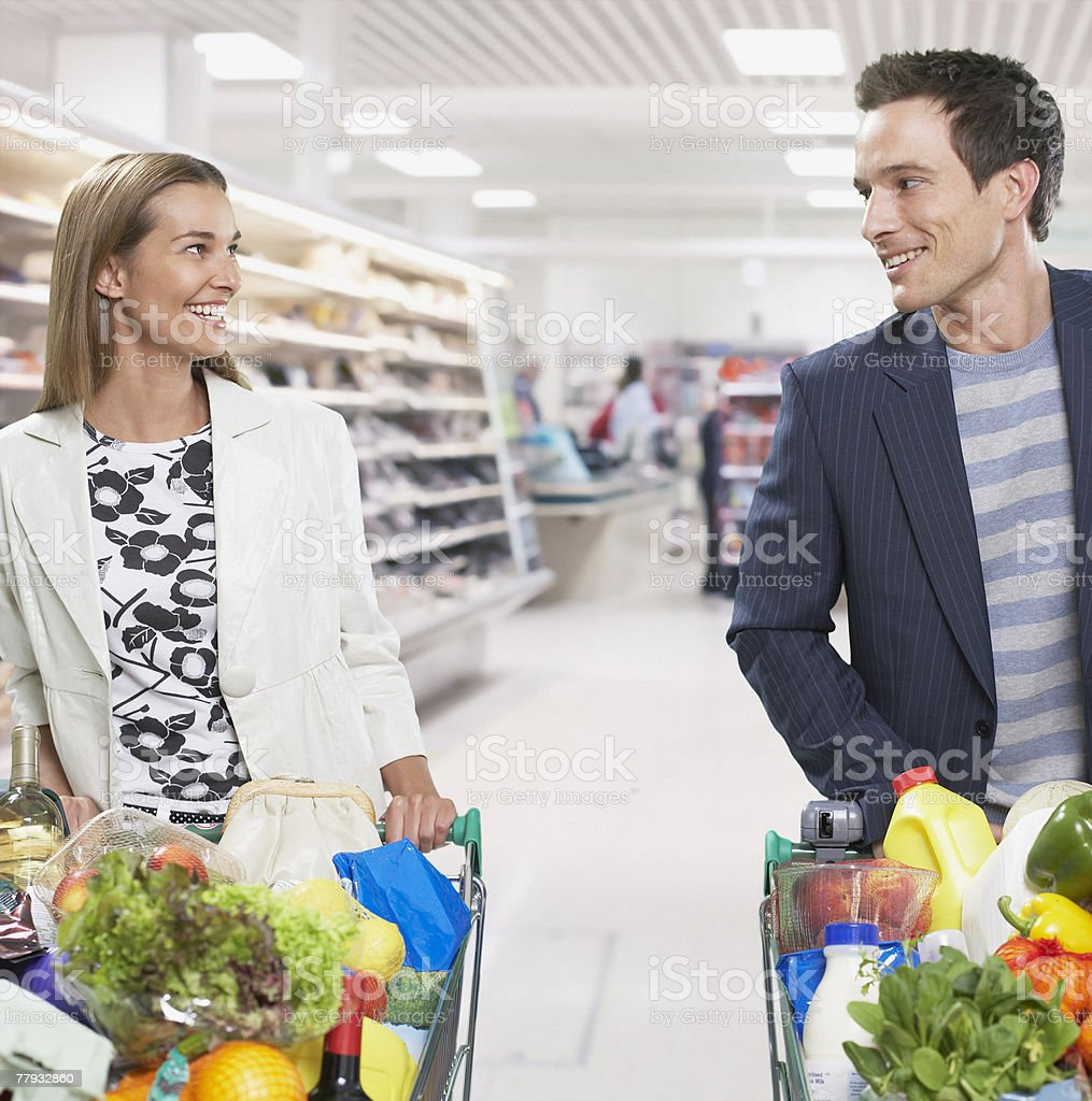 Couple grocery shopping royalty-free stock photo