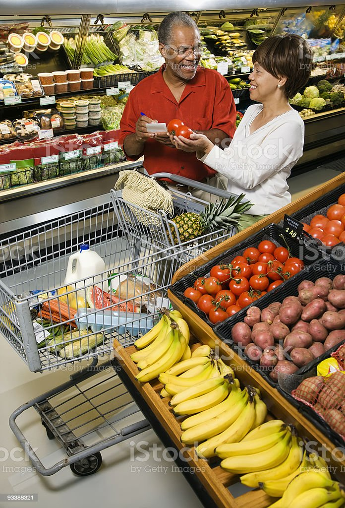 Couple grocery shopping. royalty-free stock photo
