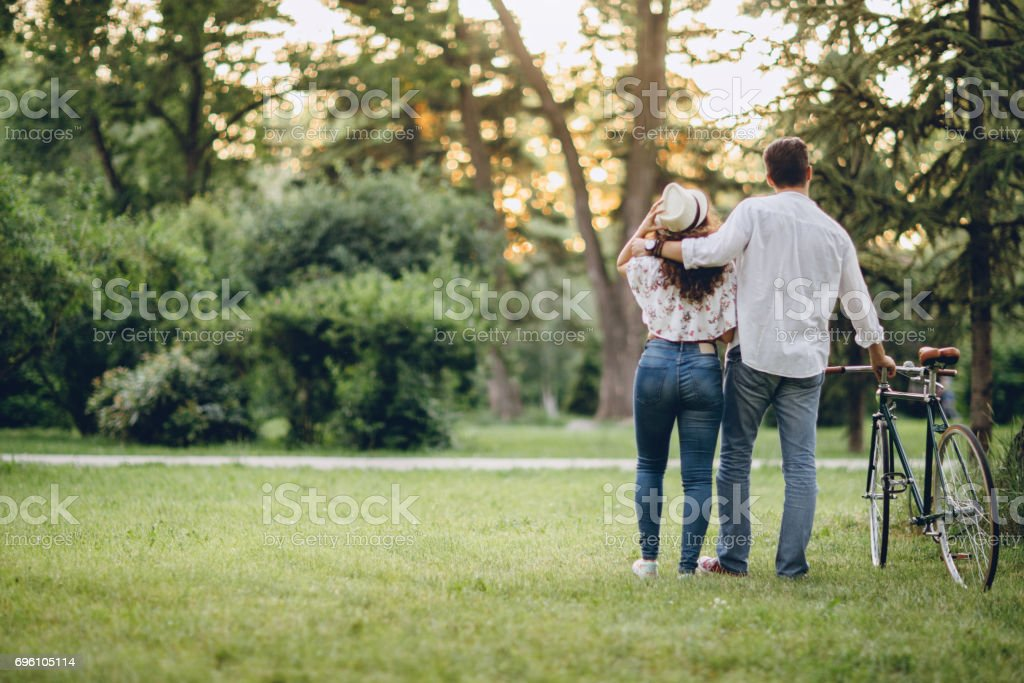 Couple with bicycle in the park