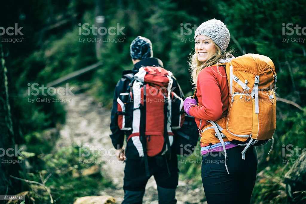 Couple happy hikers walking in mountains stock photo
