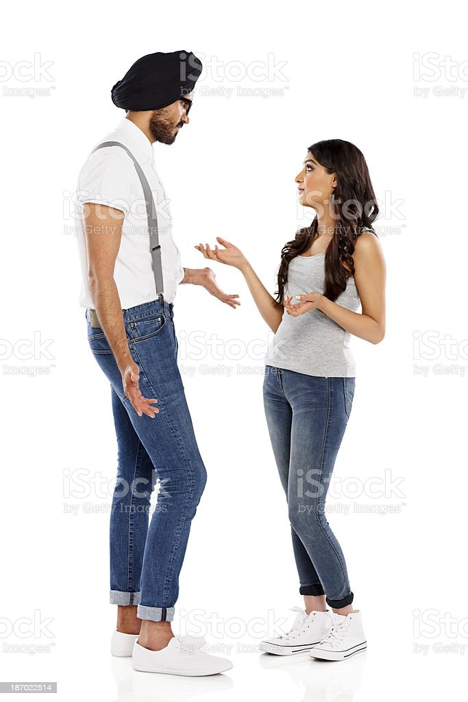 Couple having a chat on white background royalty-free stock photo