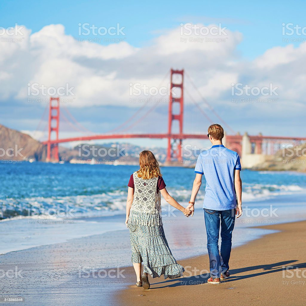 Couple having a date on Baker beach in San Francisco stock photo