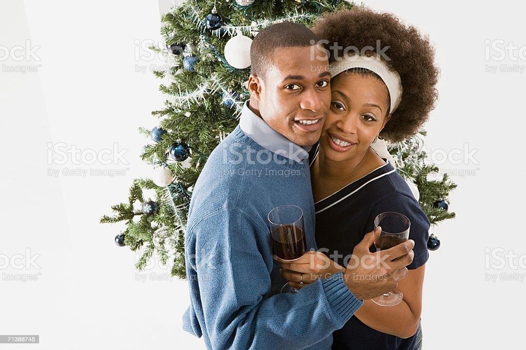 Couple having a festive drink stock photo
