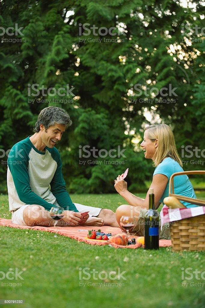 Couple having a picnic in a park stock photo