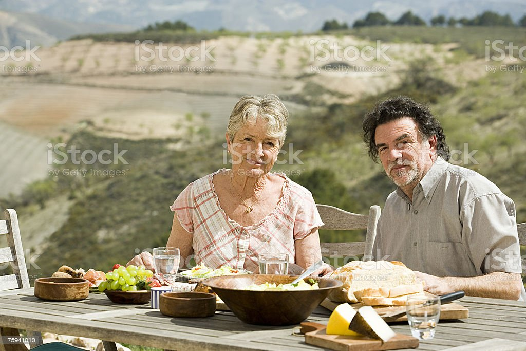 Couple having al fresco meal royalty-free stock photo